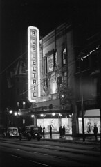 [The B.C. Electric store on Granville Street decorated for Christmas and illuminated at night]
