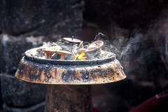 Burnt Offering (James.Breeze) Tags: nepal temple candles smoke offering kathmandu hinduism durbarsquare