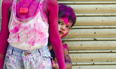 Cute Peekaboo :) (Ragavendran / Rags) Tags: girl colours brother peekaboo shutter littlegirl peek curious colourful holi camerashy cwc girlchild coloursofindia riotofcolours sowcarpet lifeiscolourful chennaiweekendclickers ragavendran behindbrother