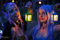 Fairies By Lamplight (wyojones (Finally Back After A Month Away)) Tags: beautiful beauty look festival tattoo night nose necklace wings eyes lowlight texas expression makeup paige lips fairy faire lamps lovely fairies renaissancefestival roxy bluehair renaissance renfest maiden wench purplehair latterns girlwoman wyojones sherwoodforestfaire