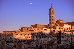 Sunset over Matera (Photos On The Road) Tags: old sunset urban italy moon heritage tourism horizontal stone outside outdoors evening town ancient europa europe italia tramonto cityscape view outdoor noone nobody nopeople luna basilicata unesco southern vista matera sassi turismo lucania nessuno outdoorshots meridionale orizzontale outdoorshot flickrsfinestimages1 bestevercompetitiongroup