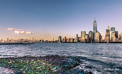 NY City (Morkos Salama) Tags: shore blue skyscrapper sky architecture buildings sunset colour stones rocks river hudson water newport ny nj