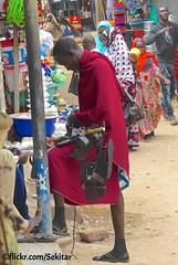 Massai Shoe Seller, Mtwara, Tanzania (Sekitar) Tags: afrique africa eastafrica ostafrika east tansania massai shoe seller mtwara pasar market tanzania