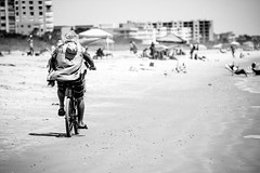 cruising along (-gregg-) Tags: coco beach florida man bike sand bw people