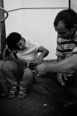 Music Lessons on the Street (stimpsonjake) Tags: nikoncoolpixa 185mm streetphotography bucharest romania city candid blackandwhite bw monochrome music mandolin lessons