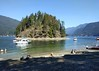 Busy day at Jug Island beach (Ruth and Dave) Tags: jugisland beach belcarraregionalpark indianarm vancouver boats boaters kayaks kayaking swimming sunbathing busy inlet sea ocean island trees forested crag rock