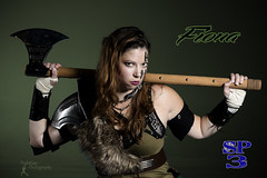 Sucker Punched 3 - Fiona (FightGuy Photography) Tags: suckerpunched womenwithweapons warriorwoman warrior badass fightguyphotography studiophotography dangerous armor brunette axe viking shieldmaiden pauldron dress green bracers cosplay