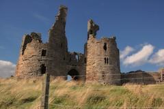 Twin Towered Gatehouse - Dunstanburgh Castle (Jeanni) Tags: twintowered gatehouse castle stone fence friday hff twin tower towered fencefriday