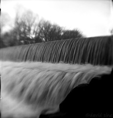 (david sine) Tags: camera old blackandwhite bw distortion film vintage waterfall newjersey kodak nj things stuff blogged brownie 620 scannednegative rahway browniehawkeyeflash flippedlens rahwayriverpark respooled