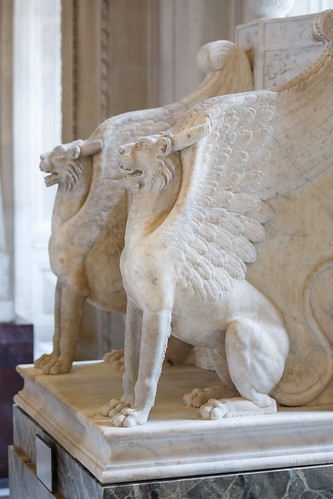 Winged, horned lions