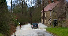 where the streets have no drains... (peet-astn) Tags: road rain flood pickup brook yesterday phonebox cottages calverton