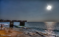 Piering At The Sun (Dion Cragg) Tags: sunset people sun pier waves crowd srilanka hdr colombo