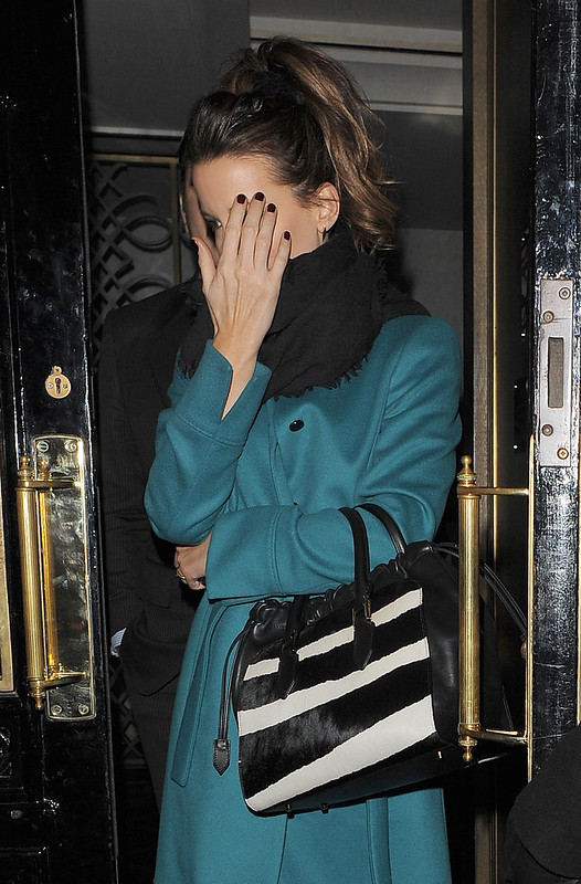 Kate Beckinsale appears rather camera-shy in Mayfair, having dined with David Walliams - WENN.com