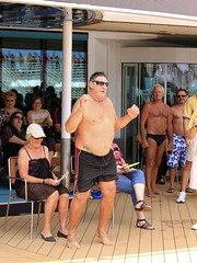 Playing to the Judges (oxfordblues84) Tags: bear cruise shirtless man smile sunglasses tattoo ship fat chest contest stomach overweight fatman rccl bikin shirtlessman radianceoftheseas overweightman royalcaribbeaninternational worldssexiestman shipcontest