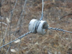 Connector (mikecogh) Tags: ceramic spiral wire cobwebs connector electricfence
