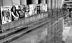 the darkness (Harry Halibut) Tags: city bw man blancoynegro wet pool rain branco hall blackwhite noiretblanc sheffield columns steps angles preto posters advertisements zwart wit weiss bianco blanc nero allrightsreserved handrails pavers noire barkers barks  schwatz     sheffieldbuildings angles angles contrastbysoftwarelaziness imagesofsheffield sheffieldarchitecture 2013andrewpettigrew sheff1212241609