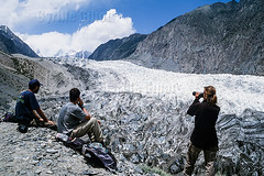 Western Tourists Looking at Passu Glacier, Ultar Valley, Hunza, Pakistan (Cyrille Gibot) Tags: travel pakistan people mountain snow ice horizontal landscape asia travellers watching scenic tourists glacier binoculars karakoram himalaya northernareas scenics passu gojal