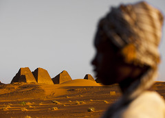 Kid In Front Of The Pyramids And Tombs In Royal Cemetery, Meroe, Sudan (Eric Lafforgue) Tags: africa travel sky brown history tourism archaeology nature cemetery horizontal architecture outdoors photography death sand memorial day child desert pyramid northafrica soedan sudan tomb tranquility teenager copyspace custom sanddune ancientcivilization khartoum nubia royalty thepast scenics oneperson lookingaway ruined soudan tranquilscene saharadesert northernafrica meroe realpeople traveldestinations colorimage naturalpattern beautyinnature buildingexterior oldruin merowe onemanonly aridclimate headandshoulder  1people szudn sudo  builtstructure northernsudan pyramidsofmeroe northsudan blackpharaohs      xuan ert7587