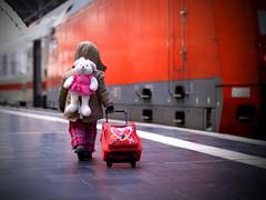 My princess... (Janissary06) Tags: travel winter red baby cold rabbit girl lines train canon germany deutschland eos 50mm princess frankfurt f14 zug hannover db manuel nikkor bahn leading turkish journalist turk deutsche photojournalist koffer ffm 500d troleybag