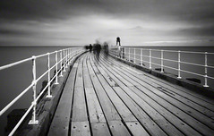ghosts of Whitby (Jon Downs) Tags: uk longexposure sea sky people bw white motion black blur art clouds digital canon downs creativity photography eos grey pier photo jon flickr artist photographer image united ghost gray creative picture kingdom pic photograph le whitby 7d ghosts phantom phantoms ghosting jondowns
