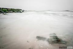 Swept Away (Towfiq Ahmed) Tags: ocean new york nyc longexposure sea motion green beach water rock outdoors movement sand nikon rocks long exposure waves jetty algae dslr ahmed dreamscape rockawaybeach d90 towfiq towfiqahmed