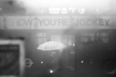 Jockey (Gary Kinsman) Tags: bw mist bus london window umbrella blackwhite fuzzy steam voyeur jockey f18 hazey camdentown voyeurism obscure nw1 camdenroad insidelookingout canon28mmf18 canoneos5dmarkii canon5dmkii showyourejockey