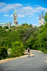Cycling (Duda Arraes) Tags: trees ontario canada building tower bike sport architecture cycling ottawa bluesky trail northamerica parliamenthill federation nationalcapital