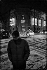 david_szpunar_photography_six_corners_snowstorm (deszpuna) Tags: blackandwhite wickerpark chicago candid snowstorm streetphotography nighttime