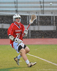 Under the Lights and In the Rain (Scottwdw) Tags: newyork sports boys rain weather ball spring nikon bees helmet safety highschool east varsity gloves syracuse henniger stick passing lacrosse pouring baldwinsville blackknights sectioniii afsvrzoomnikkor70200mmf28gifed d7100 scottthomasphotography