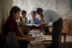 Rajmai studying with classmates. (ActionAid UK) Tags: poverty charity school nepal rural children reading education child classroom classmates photojournalism documentary teacher will gift agency secondary lower studying development ngo jyoti actionaid