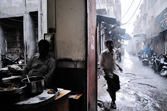 Wet (Giannis Papanikos1) Tags: street woman india man rain photography nikon asia south documentary social monsoon varanasi rickshaw gsp jaipur rajasthan 2012 jodhpur uttar giannis hindus d700 papanikos