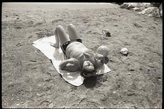 (Beach Balls) (Robbie McIntosh) Tags: leicam2 leica m2 rangefinder streetphotography 35mm film pellicola analog analogue negative leicam summilux analogico leicasummilux35mmf14i blackandwhite bw biancoenero bn monochrome argentique summilux35mmf14i autaut dyi selfdeveloped filmisnotdead strangers candid arsimagofd arsimagofddeveloper kentmere400 kentmere 400 beach onthebeach bathers summertime summer woman fat supersantos lidomappatella mappatellabeach tits