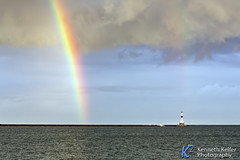 Rainbow and Conneaut Light (Kenneth Keifer) Tags: aid america ashtabula ashtabulacounty beach beacon black blue breakwater coast conneaut conneautlight conneautlighthouse conneautwestbreakwaterlighthouse dark dawn erie greatlakes historic horizon lake lakeerie landscape light lighthouse maritime marker midwest moody morning nautical navigation navigational ohio rainbow seascape shining shipping spectum splash spray stormy tower transportation unitedstates usa waves westbreakwater white