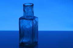 Old bottle (Crisp-13) Tags: bottle glass blue flash gel back lit old