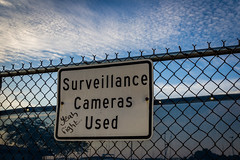 Funny Sign (mraarondouglas) Tags: racine wi wisconsin north beach pier sun sunrise water lake michigan clouds cloud morning dawn colors colorful color summer hummid dew calm peaceful peace orange yellow pink beaches waterfront fish sand waves wave surveillance camera used cameras sign fence funny question canon rebel t5 1200d image photography photo photograph il illinois chicago milwaukee