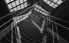 ... (m_travels) Tags: architecture stairs windows lines trainstation platform symmetry filmphotography analog argentic 35mm kodaktmax400 1600 pushprocessing experiment doubleexposure sooc negativescan bartstation underground metro subway sf abstract art bw blackandwhite filmgrain