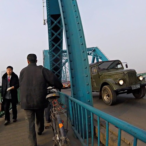 Once upon a time on Taedong Bridge, Pyongyang, North Korea. - #latergram (December, 2015) 📷 GoPro Hero4 Session - #pyongyang #northkorea #dprk #korea #koreautara #photography #fotografi #travel #traveling #traveler #story #travelfotografi #travelph