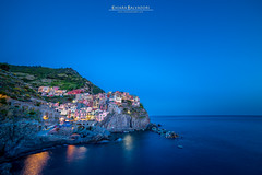 Manarola (Chiara Salvadori) Tags: bellaitalia bluehour cinqueterre fivelands italianriviera laspezia longexposure mediterraneansea nightshot travelphotography bay beautiful blue cliff coast colors harbour italy landscape lifestyle lights liguria manarola night outdoors places port premiun rocks scenery sea seascape sky spring sun terraces tourisme travel traveling trip unesco village water