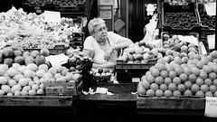 no customers (tamaratoth) Tags: market seller fruits sad orange old lady lemon apple