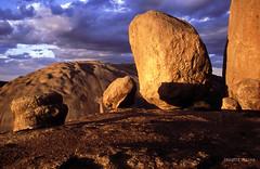 Balancing Rock on the Pyramid, 1996 (NettyA) Tags: park sunset canon rocks fuji 1996 australia boulders velvia national bushwalking scanned qld queensland granite balancingrock girraween eos500 thepyramid 35mmslidefilm granitebelt