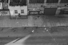(tessaswag) Tags: street nyc light shadow woman man strange brooklyn pose blurry shoes sitting view apartment perspective streetphotography surreal running williamsburg fleeting magichour downward onlooker documentaryphotography lateafternon canon60d