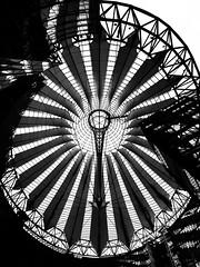 Elliptic anomaly (megorgar) Tags: roof bw white black berlin wheel architecture forum ferris ellipse potsdamerplatz sonycenter architektur sw schwarz riesenrad helmutjahn elliptic weis elliptisch silverefexpro2 nikcollection