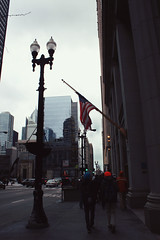 (emily mucha) Tags: city chicago storm flag american pedestrians