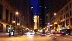 Ceres on the Board of Trade overlooking traffic on LaSalle Street (John Hill Photography) Tags: street city blue sky chicago cars car yellow architecture night canon buildings lights traffic district tripod trails cityscapes sigma clear pedestrians crosswalk 1770 financial f28 f4 ceres manfrotto t3i boardoftrade cartrails lasallestreet 1770mm