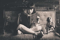 Scary Story Time (Kilkennycat) Tags: portrait cute girl cat canon vintage children reading book kitten child 50mm14 story converse storytime settee dantesinferno 500d kilkennycat t1i ryanconners