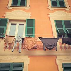 Italian villages I (Juste Pixx) Tags: italy europe liguria sori genua orange laundry mediterranean warm summer facade windows colorful vsco vintage canon6d