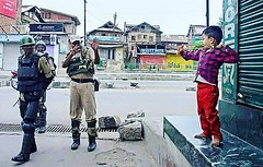 A kashmiri kid playing with security forces somewhere in Sri nagar Isn't that cute for a morning post? :)) (contfeed) Tags: kashmiri kid playing security forces
