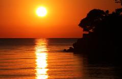 Serenity (craigsanders429) Tags: sunset sun sunsetphotography lakeerie lakeerieinohio water greatlakes catawbaisland catawbaislandstatepark ohio settingsun yellow red orange serenity