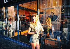 Passion For Fashion (Steve Lundqvist) Tags: fashion victim girl shooting street blonde berlin germany berlino sidewalk path sun light warm color tshirt shorts clothes moda model wearing hair shopping shop shot bags bag teen teenager young happy trend vogue cast casting modella pretty woman deutschland nikon d700 24mm reflex reflection passion addicted addiction