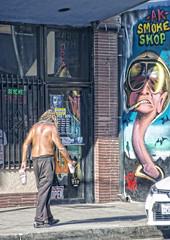 STREET (akahawkeyefan) Tags: tower district davemeyer fresno man shirtless smoke shop street